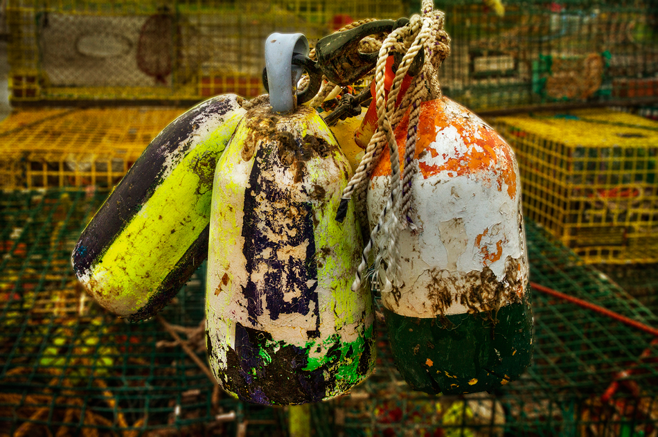 The lobster traps and buoys provide colorful backdrops at the marina; a sensory overload of grit, peeling paint, unidentifiable odors, rust and fluorescent colors!