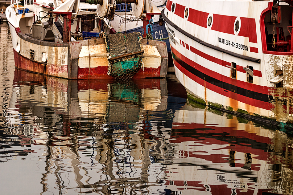 Nautical reflections were especially vibrant as the fishing boats returned shortly after sunrise. Cherbourg is a city and ferry port situated on the Cotentin Peninsula in Lower Normandy in north-western France.